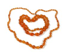 An amber necklace, formed of faceted oval and circular beads,