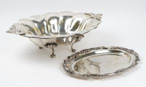 A plated shaped oval twin handled large bowl, with martele decoration,