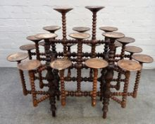 A stained beech bobbin turned multi-tier plant stand, 100cm wide x 85cm high.