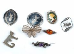 A group of mostly silver jewellery, comprising; eight brooches,