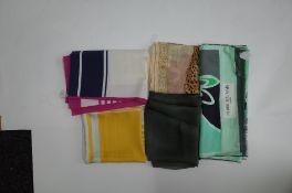 A collection of designer silk scarves comprising a Salvatore Ferragamo example;