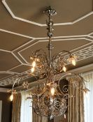 A silvered wrought metal six light chandelier,