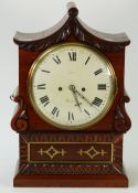 A late Regency rosewood bracket clock, of shaped outline,