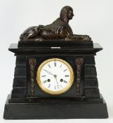 A French black slate mantel clock, surmounted by a bronze model of a sphinx, with a 4.