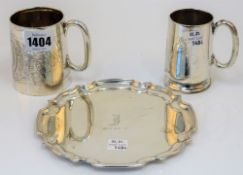 Silver, comprising; a christening mug of tapered cylindrical form, with engraved decoration,