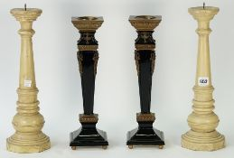 A pair of cream painted wooden pricket sticks, 39cm high,