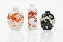 Three Chinese porcelain snuff bottles, late 19th/20th century, comprising; a cylindrical bottle,