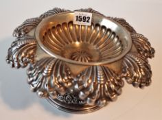 An Austrian pedestal bowl of shaped circular form, the wide rim with stylized scalloped motifs,