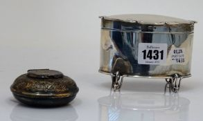 A silver oval hinge lidded tea caddy, raised on four wirework feet, Birmingham 1904,