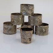 A set of six Chinese napkin rings decorated with dragons and a Chinese miniature bucket with