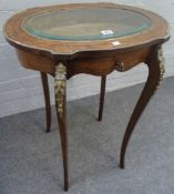 A late 19th century French gilt metal mounted mahogany oval bijouterie table,