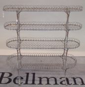 A late Victorian wirework graduated four-tier conservatory plant stand,