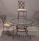 A circular metal and glass dining table, 230cm diameter,
