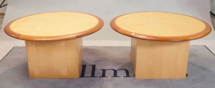 A pair of modern circular low occasional tables on square plinth bases, 80cm diameter x 40cm high,