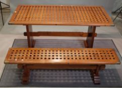 A campaign style brass bound teak rectangular dining table, 68cm wide x 155cm long,