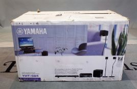 A Yamaha YHT-594 surround sound system, boxed.