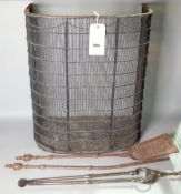 A 19th century nursery fender, 55cm wide and a group of three fire tools, (4).