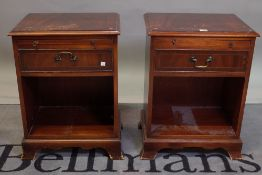 A pair of modern mahogany single drawer bedside chests on bracket feet, 46cm wide x 60cm high.