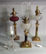 A group of three early 20th century brass oil lamps, later converted to electricity,