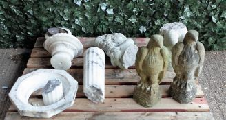 Garden statuary comprising a 20th reconstituted stone figure of a cherub,