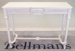 A modern white painted Continental side table with on fluted tapering supports,