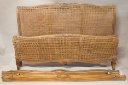 A stained beech and canework double bed, 117cm wide x 118cm high.