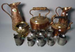 Metalware, comprising; two Art Nouveau copper jugs, the tallest 24cm high,