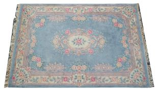 A Chinese hooked carpet, pale blue field, 276cm x 190cm.