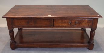 An 18th century style oak, two drawer coffee table, 122cm wide x 55cm high.