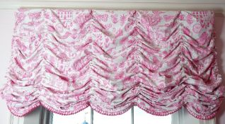 Three Roman blinds, printed in pink with birds, butterflies, trees and buildings,