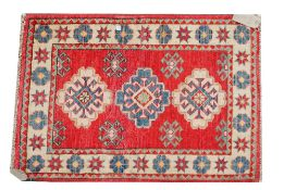 A Turkish mat, red field, 96cm x 67cm, and a Tekke Turkmen mat, 96cm x 53cm, (2).