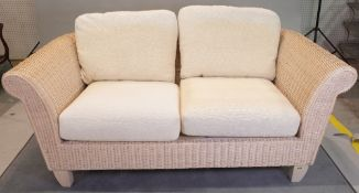 A wicker conservatory suite comprising; a sofa, 170cm wide x 70cm high, and two armchairs,