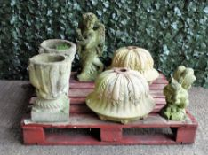 Garden statuary comprising a pair of modern reconstituted stone urns with leaf moulded decoration,