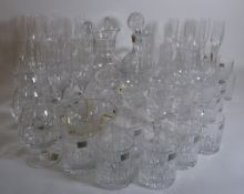 Glassware; a large quantity of modern cut glass drinking glasses, including Mikasa,