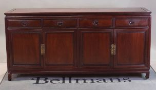 A modern Chinese hardwood sideboard with four drawers over cupboard base, 185cm wide x 90cm high.