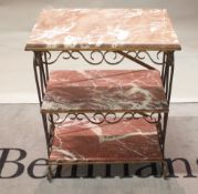 A gilded wrought metal rectangular three tier etagere, inset with rouge royal marble panels,