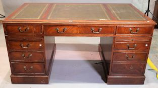 An early 20th century stained beech pedestal desk, 115cm wide x 78cm high.