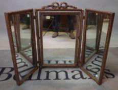 An 18th century style gilt gesso framed triptych mirror, 107cm wide x 70cm high.
