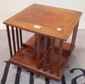 An Edwardian mahogany and satinwood banded revolving bookcase, 35cm wide x 35cm high.