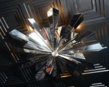 A contemporary chromium starburst light fitting, 120cm diameter.