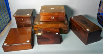 A 19th century mahogany tea caddy, a small two drawer chest and four further boxes,