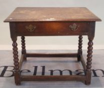 An 18th century oak single drawer low side table on bobbin turned supports, 77cm wide x 63cm high.