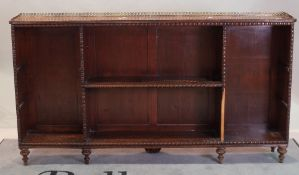 A 19th century mahogany open bookcase with split beading decoration on turned supports ,