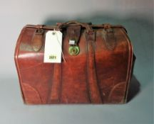 An early 20th century leather doctor's bag, 45cm wide x 33cm high.