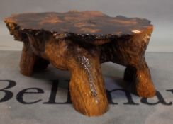 A painted resin root coffee table, 65cm wide x 40cm high.