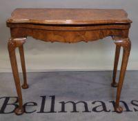 An 18th century style burr walnut demi-lune card table, 94cm wide x 76cm high.