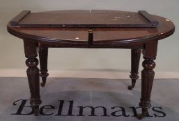 A 19th century mahogany oval extending dining table, with one extra leaf on turned supports,