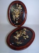 A pair of modern Asian oval wall plaques,