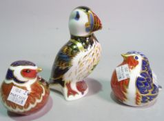 Three Royal Crown Derby paperweights all modelled as birds, including a Puffin.