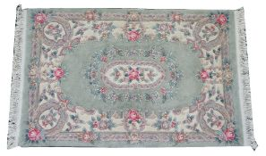 A Chinese rug, sage floral field, 196cm x 125cm. Condition Report Very good.
